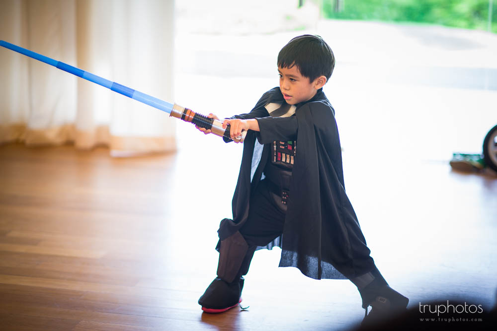 Aaron posing in full battle suit at his Star Wars Theme birthday party at Tanah Merah Country Club