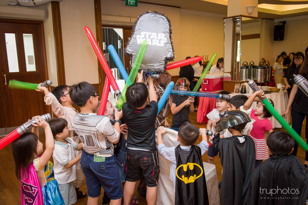 Children rushing to grab candies from Star Wars theme pinata kit at birthday party of Aaron & Isaac at Tanah Merah Country Club