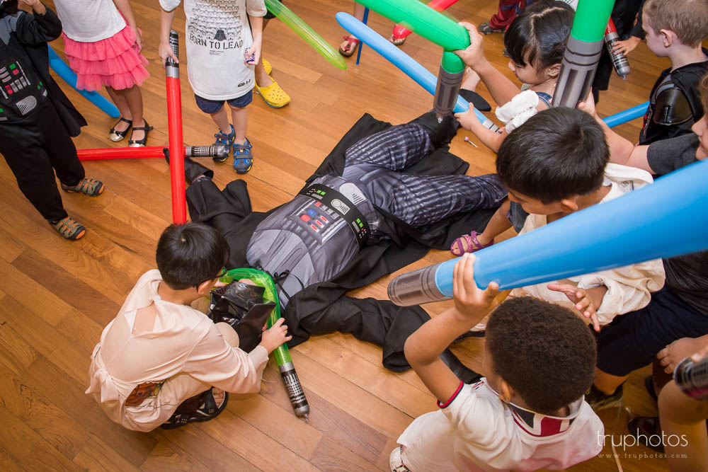 Kid strangling Darth Vader at birthday party of Aaron & Isaac at Tanah Merah Country Club