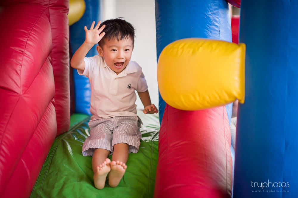 Yu Kang, brother of Yu Cheng, having fun on the bouncy castle
