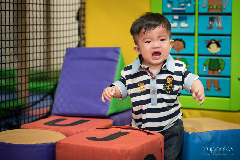 An upset Lucius at the children's indoor playground