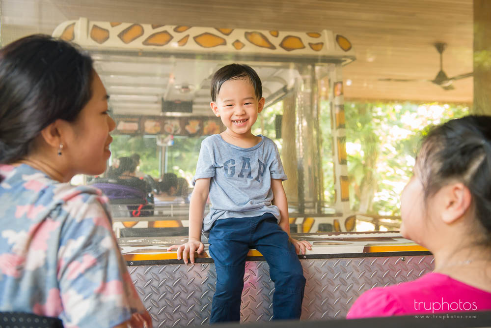 Smiling moment of Aden sitting on the zoo tram