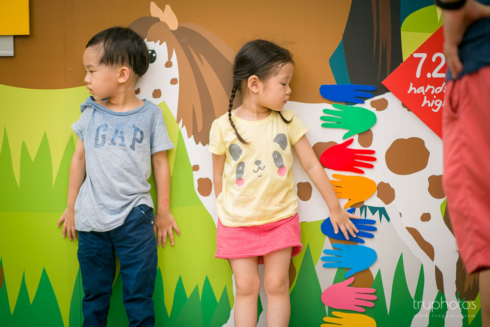 Candid posed shot of Yu Xuan and Aden against a colourful wall